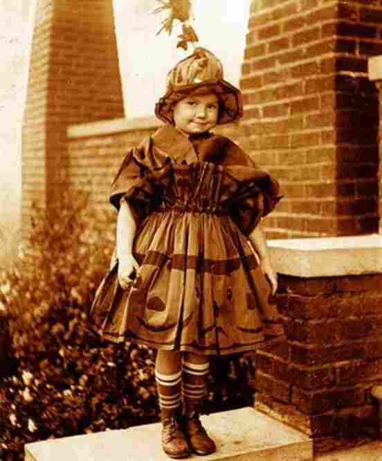 """This cute little girl used Halloween crepe paper to fashion her costume in the 1920s. The image is from my collection of vernacular photography."""