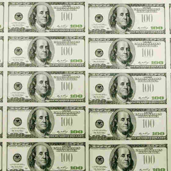 Sheets of $100 bills wait to be cut into singles at the Bureau of Engraving and Printing in Washington, D.C. In recent decades, the gap between rich and poor has widened in the United States.