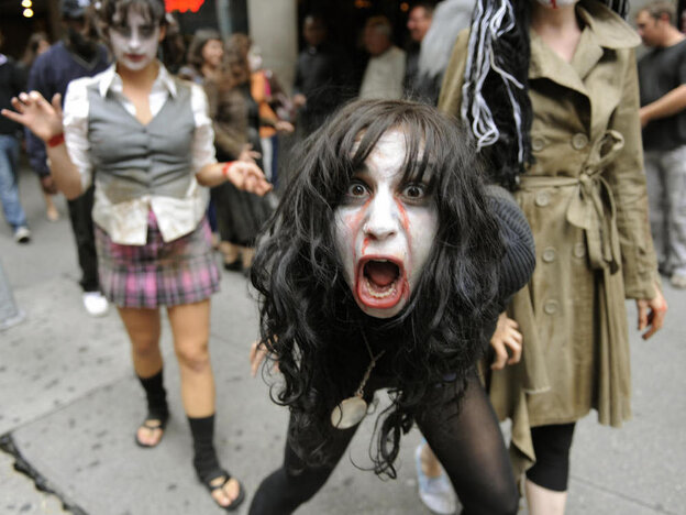 Actors dressed as zombies walk around Times Square in 2009.