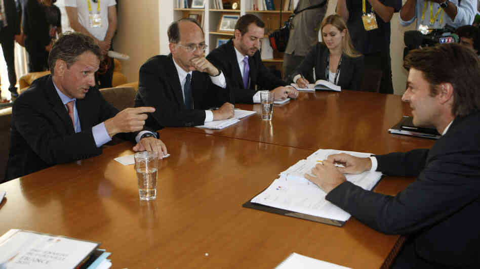 U.S Treasury Secretary Timothy Geithner (left) speaks to French Finance Minister Francois Baroin (right) during talks in Marseille in September. While the U.S. has been concerned about Europe's debt crisis, the Americans have not been major players.