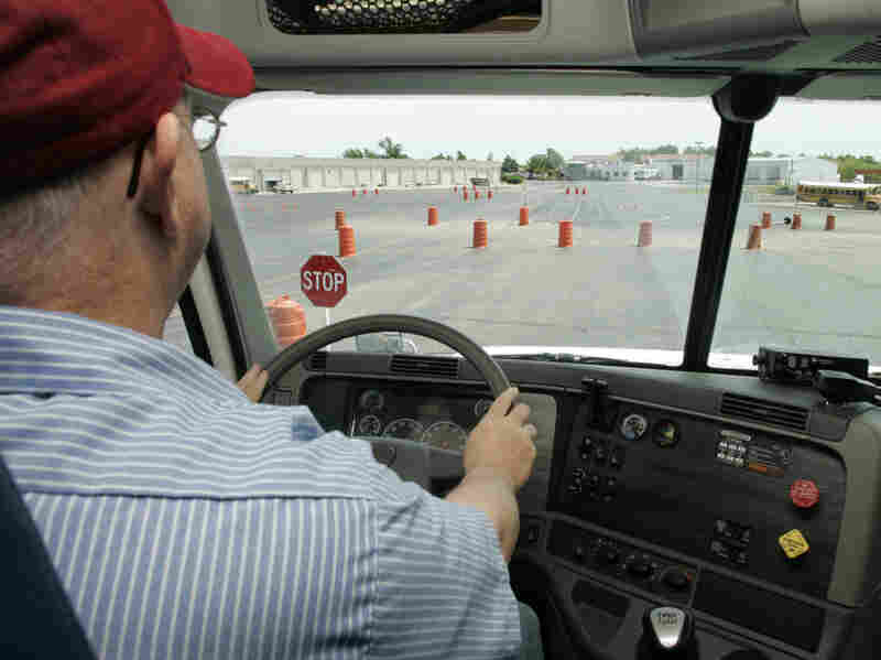 Student Tommy Wood sits in the driver's seat of a training truck at Central Tech truck-driver training in Drumright, Okla.