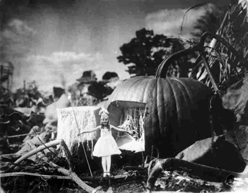 """Photomontage of a fairy standing outside of her pumpkin home, Detroit, Mich., circa 1928"""