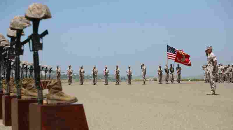 Marines with 3rd Battalion, 5th Regiment salute during the playing of taps at a memorial ceremony on April 29 at Camp Pendleton, Calif. Moments before, the Marines fired a 21-gun salute in honor of the 25 fallen warriors of the battalion.