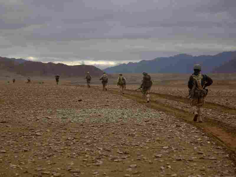 Marines of the 3rd Battalion, 5th Regiment conduct a search operation in Sangin district, Afghanistan, on Feb.18, 2011. Roadside bombs were a constant threat on such patrols.
