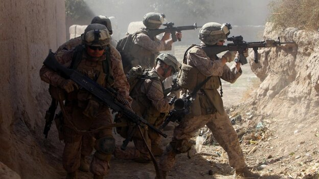 U.S. Marines with 3rd Battalion, 5th Regiment and the Afghan National Army provide cover as they move out of a dangerous area after taking enemy sniper fire during a security patrol in Sangin, Afghanistan, in November 2010. During its seven-month deployment, the 3/5 sustained the highest casualty rate of any Marine unit during the Afghan war, losing 25 men.