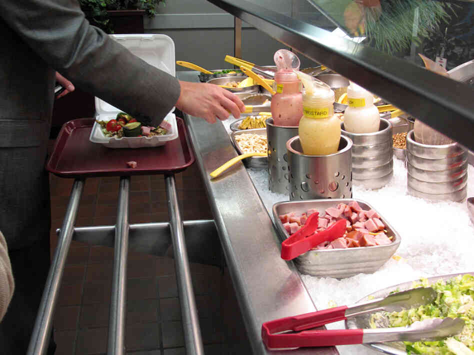 To encourage healthy choices, Dow's corporate cafeteria features color-coded utensils. Healthy foods like broccoli, spinach and beets have green handles. Yellow handles mean caution, and red is for temptations like bacon bits and high-fat dressing.