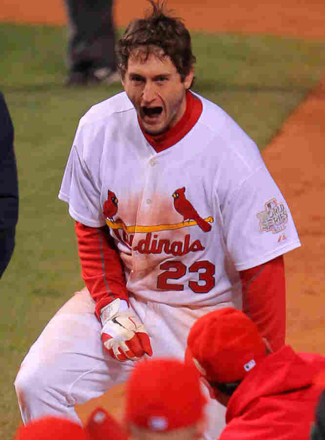 David Freese of the St. Louis Cardinals celebrates at home plate after hitting a walk-off solo home run in the 11th inning to win Game Six of the MLB World Series against the Texas Rangers in St Louis.