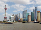 Lujiazui, Shanghai's financial district, includes the world's third- and sixth-tallest buildings. The city's population is 23 million.
