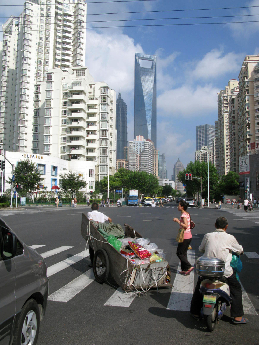 Despite its ultra-modern skyscrapers and paved streets, some Shanghai residents still transport items on carts.