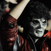 "A fan dressed as Michael Jackson's zombie character participates in the 2009 ""Thrill the World: A Global Tribute to Michael Jackson"" in Astoria Park in the Queens section of New York."