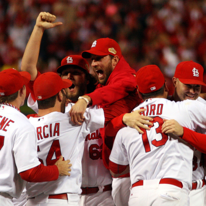 The St. Louis Cardinals celebrate after defeating the Texas Rangers 6-2 to win the World Series in Game 7 at Busch Stadium in St Louis, Miss., on Friday.