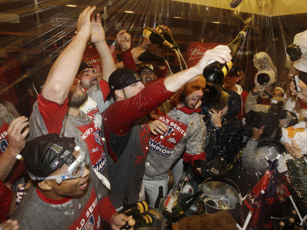 Celebration: The St. Louis Cardinals spray Champagne after Game 7 of baseball's World Series against the Texas Rangers in St. Louis.
