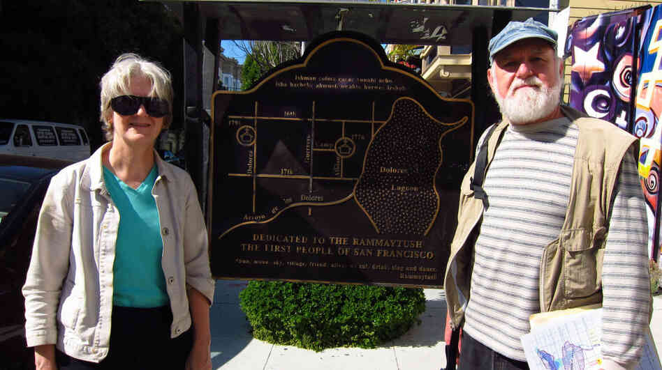 Creek geologists Janet Sowers and Christopher Richard stand next to a plaque that puts a lagoon in San Francisco's Mission District.