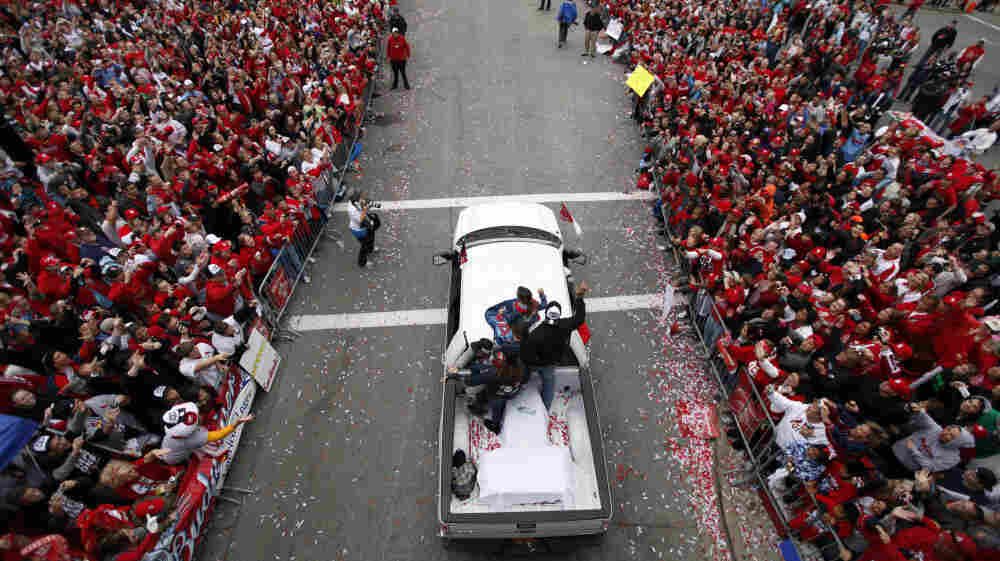 St. Louis Cardinals first baseman Albert Pujols, top right, waves to fans during a victory parade on in St. Louis, after the Cardinals defeated the Texas Rangers to win their 11th baseball World Series in franchise history.