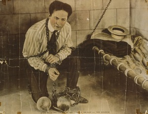 "Harry Houdini started performing as a professional magician in the U.S. in 1891. The caption at the bottom of this photo reads: ""Stone walls and chains do not make a prison — for Houdini."""