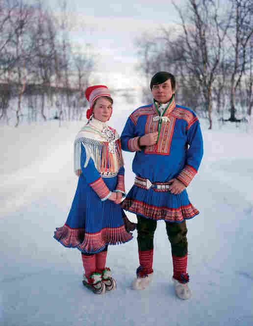 Sara Gaup, 14, is dressed for her confirmation. The garb that she and her father, Nils Peder, wear identifies their hometown as Kautokeino, Norway. The upturned tips of their reindeer-hide boots were designed to hook into skis.