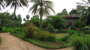 Peou Nam's traditional Khmer farmhouse on stilts in the countryside of Kampot province. Peou settled there after surviving the Khmer Rouge's attempts to execute him. He remarried and has six children with his second wife.