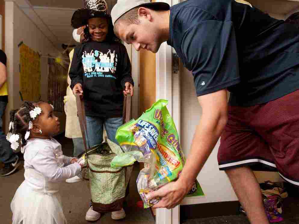 At Washington University in St. Louis on Sunday, student Andrew Dwoskin was handing out candy to local children