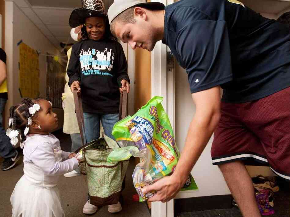 "At Washington University in St. Louis on Sunday, student Andrew Dwoskin was handing out candy to local children during a ""Safe Trick-or-Treat"" event."