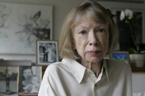 Sitting behind Didion in her New York apartment are photographs of herself holding Quintana Roo, and a photograph from Quintana Roo's 2003 wedding.