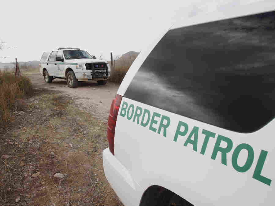 U.S. Border Patrol vehicles drive from a checkpoint in December 2010, as teams of border officers comb the Arizona desert about 10 miles north of Mexico in search for a suspect in the fatal shooting of U.S. Border Patrol agent Brian Terry in the rugged terrain in Rio Rico, Ariz.