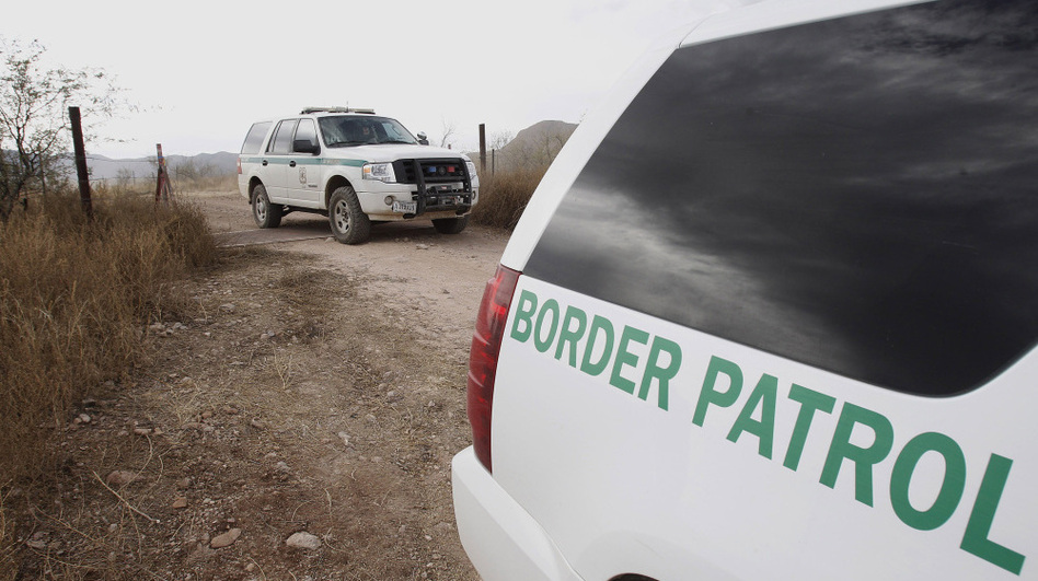 <p> U.S. Border Patrol vehicles drive from a checkpoint in December 2010, as teams of border officers comb the Arizona desert about 10 miles north of Mexico in search for a suspect in the fatal shooting of U.S. Border Patrol agent Brian Terry in the rugged terrain in Rio Rico, Ariz. </p>