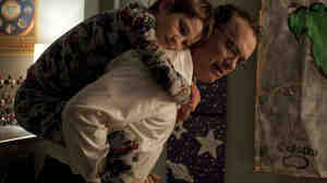 THOMAS HORN as Oskar and TOM HANKS as Oskar's father in  EXTREMELY LOUD & INCREDIBLY CLOSE.