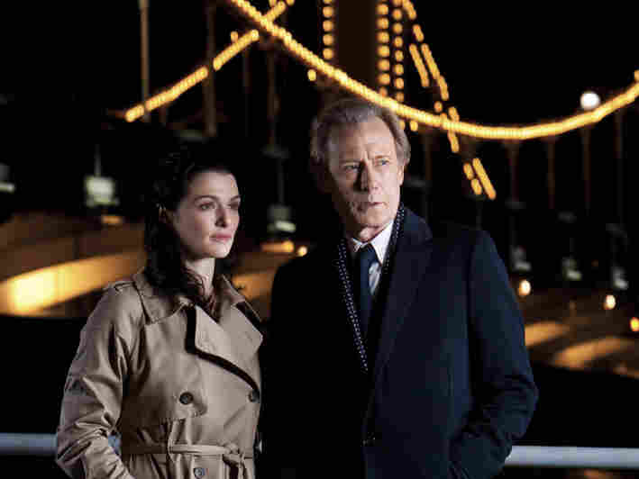 In Page Eight, Bill Nighy plays Johnny Worricker, a spy trying to help his neighbor Nancy Pierpan (Rachel Weisz) discover how her brother died.