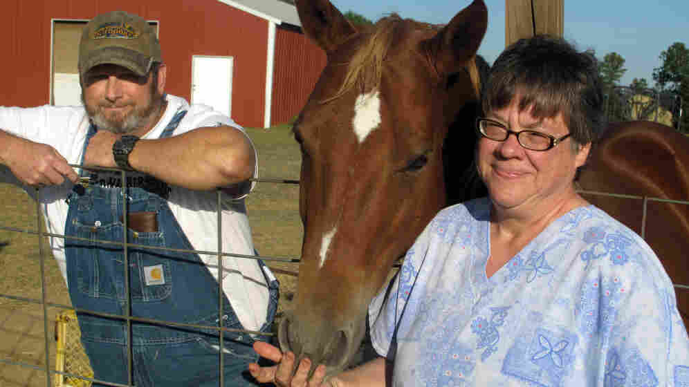 Norris and Janis Galatas at their home in Collinsville, Miss., with their horse, Cinnamon. The couple is struggling to make their mortgage payments.