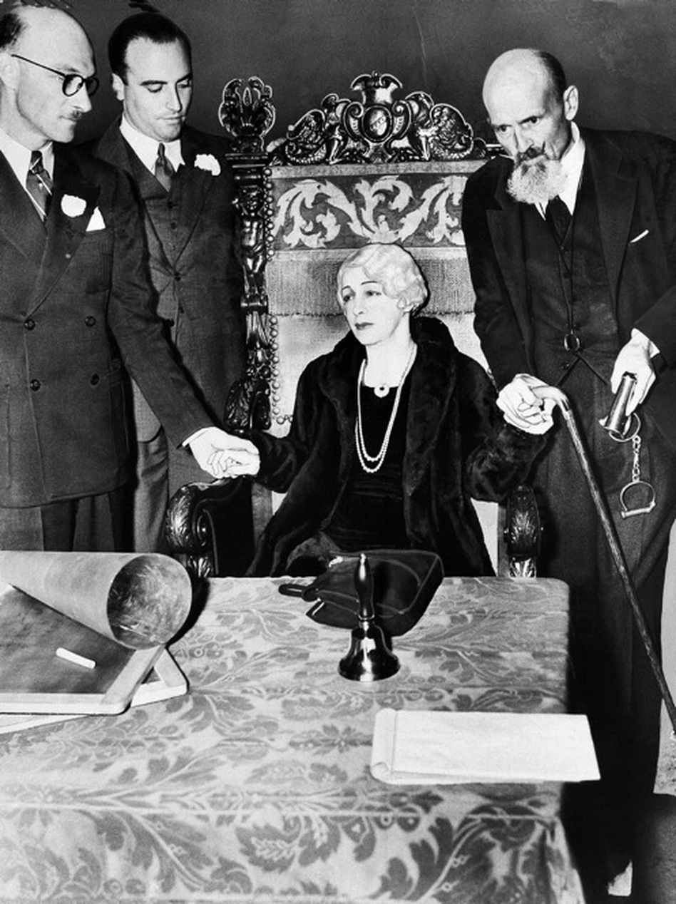 Bess Houdini, Harry's widow, held a series of séances after his death in an unsuccessful attempt to contact him in the afterworld. Here she is seen during her last séance, 10 years after his death. Bess died in 1943.  (NPR)