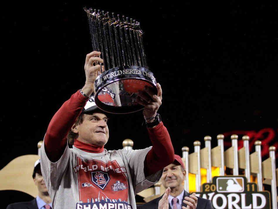 Cardinals manager Tony La Russa celebrated with the World Series trophy Friday night in St Louis.