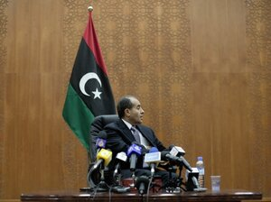 Libya's Transitional National Council premier Mahmud Jibril addresses a press conference in Tripoli on Oct. 30, 2011. Misrata militias are carrying out revenge attacks on the displaced residents of the nearby town of Tawargha, a stronghold of Moammar Gadhafi loyalists.