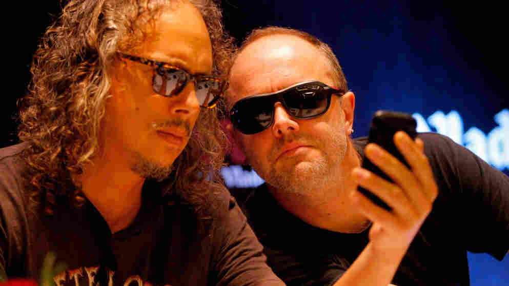 Heads together: We wouldn't want to suggest that Kirk Hammett (left) and Lars Ulrich are actually plotting new strategies for infuriating their loyal followers in this photo. But they do seem to be up to something.