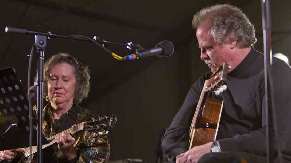 Mary Flower and Pat Donohue perform on Mountain Stage in Grand Marais, Minn., at the North House Folk School.