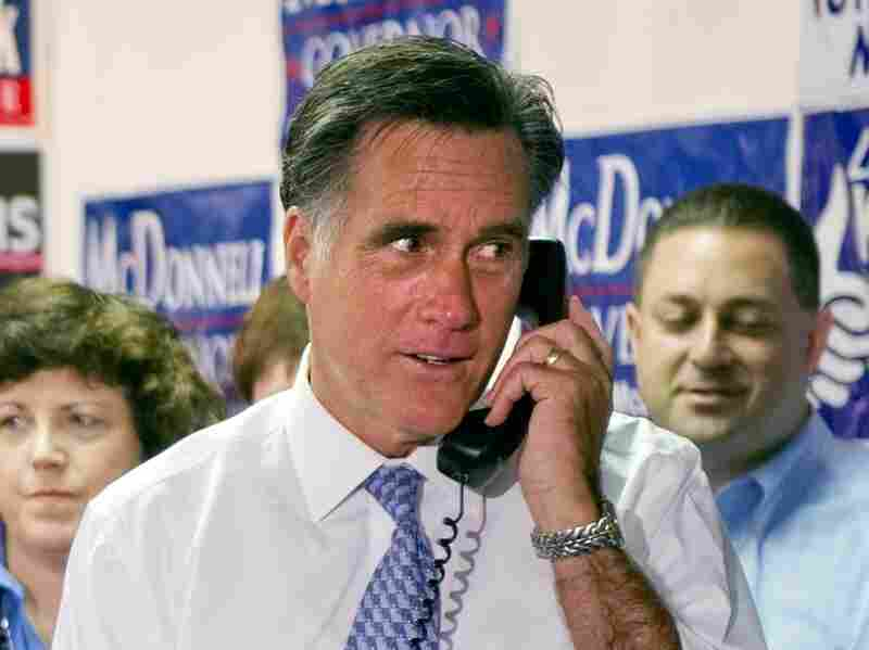 Republican presidential candidate former Governor Mitt Romney, R-MA makes a phone call as he greets and thanks Fairfax County Republican Committee phone bank volunteers at their headquarters in Fairfax, Virginia, Oct. 26, 2011.