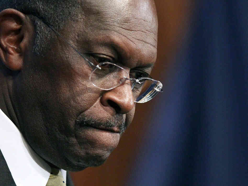 "Republican presidential candidate Herman Cain speaks Monday at the National Press Club in Washington, D.C. During a question and answer portion of the program, Cain called the accusations of sexual harassment against him ""a witch hunt."""