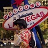 Rodrigo Gonsalez walks along the Las Vegas Strip as he finishes up a night of impersonating Elvis. Gonsalez, a welder by trade, turned to street performing in the absence of construction jobs in the city.