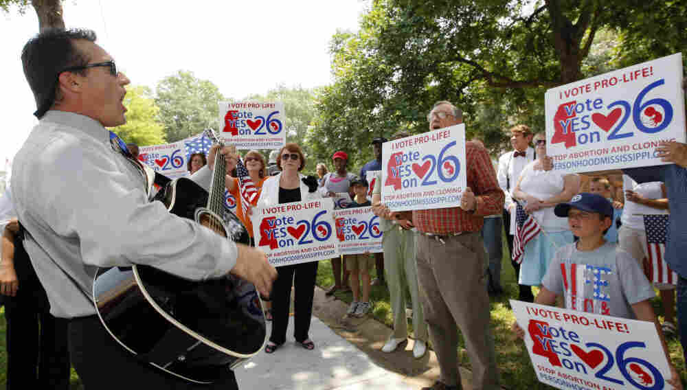 Supporters of a constitutional amendment that says human life begins at the moment of fertilization gather at a prayer rally in Jackson, Miss., in June. Residents will vote on the amendment Nov. 8.