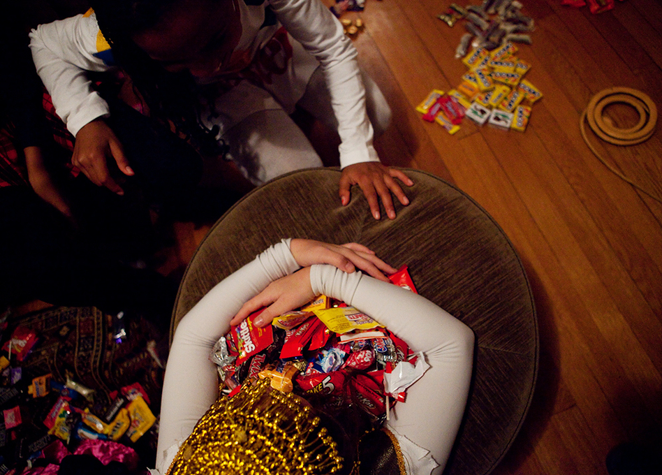 <p>Sierra Lewter grabs a coveted candy after trick-or-treating on Halloween. </p> (Melissa Forsyth/NPR)