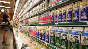 A customer studies a display of milk and dairy products at Bryan's Grocery in San Francisco in March.