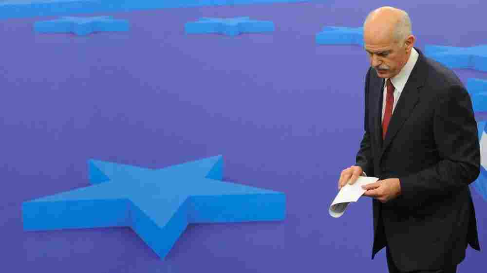 Greek Prime Minister George Papandreou leaves a news conference after a meeting with European Council President Herman Van Rompuy on Oct. 13 at EU headquarters in Brussels. EU leaders were surprised and angered Tuesday when Papandreou said he would place a debt restructuring proposal before Greek voters.