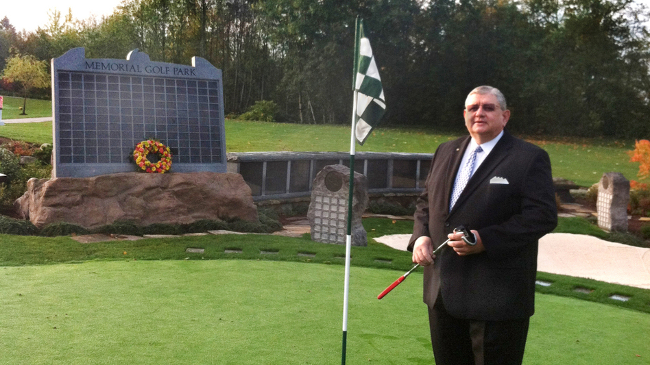 "<p>Memorial Golf Park creator Arne Swanson stands on its putting green — an ossuary with enough capacity to hold 600 former avid golfers. Families can purchase a spot on the solemn ""leader board"" to preserve the loved one's standing for all eternity. </p>"