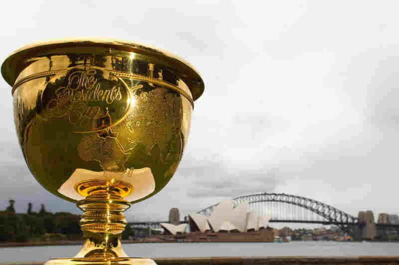 The Presidents Cup, on display in front of the Sydney Opera House and the Sydney Harbour Bridge in Australia. It's unclear to Frank Deford exactly what the Presidents Cup is — he knows only that it's played in November.