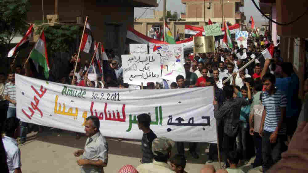 Anti-government protesters march in the village of Amouda, Syria on Sept. 30. For many Syrians, the protests mark the first time they have taken part in anything resembling politics.