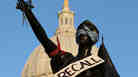 """A sign that reads """"recall"""" hangs on a statue in front of the Wisconsin state Capitol last month in Madison. Labor groups are making an effort to recall Gov. Scott Walker for his controversial union rights law."""