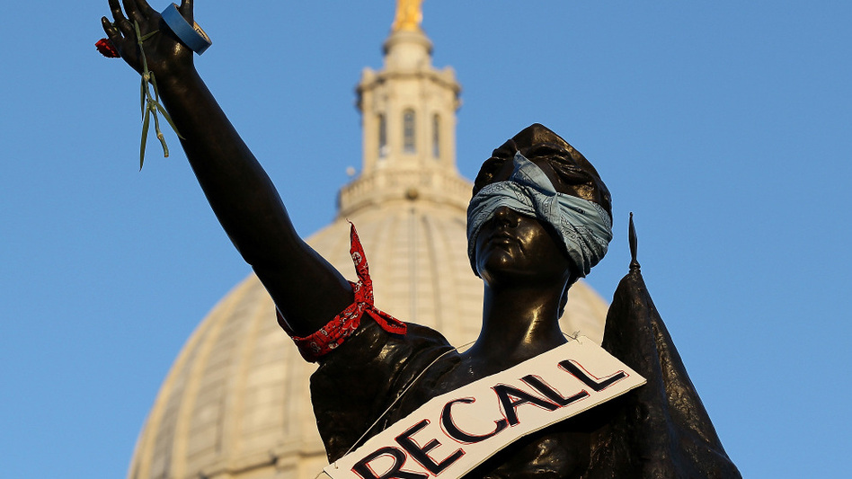 """<p>A sign that reads """"recall"""" hangs on a statue in front of the Wisconsin state Capitol last month in Madison. Labor groups are making an effort to recall Gov. Scott Walker for his controversial union rights law.</p>"""