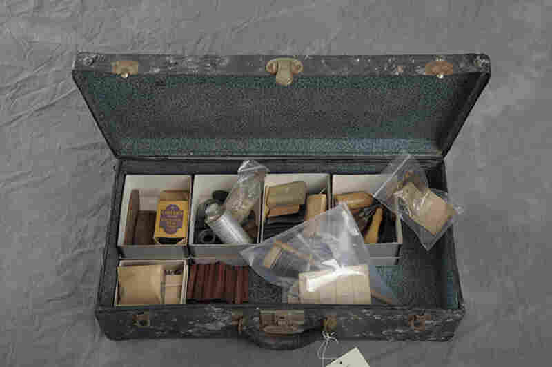 A suitcase owned by Maude Ketchman contains tools and materials for crafting.
