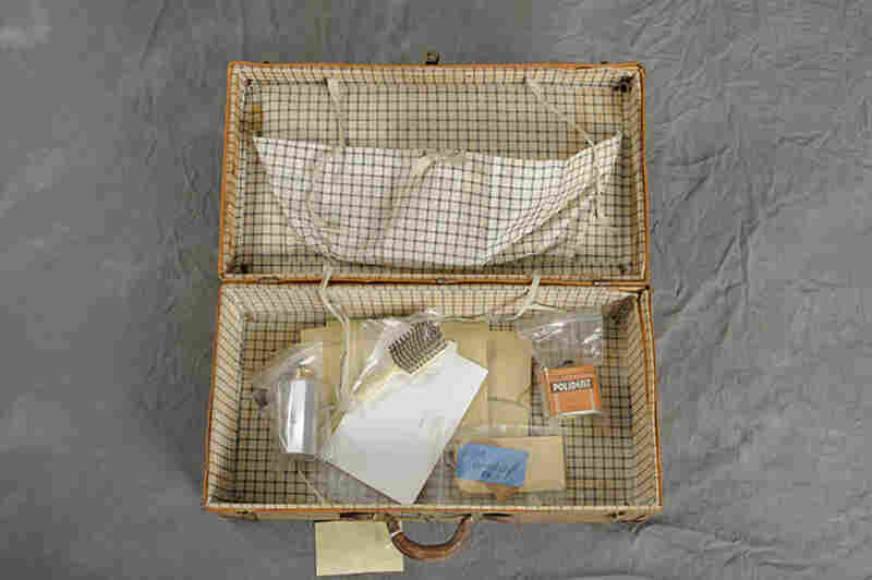 Fred Butters brought with him to Willard a metal container of talc, a Polident can, blank postcards and letters.