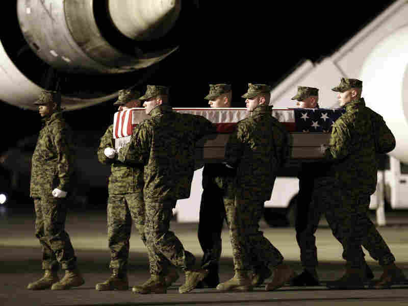 Marines carry the remains of Cpl. Derek Wyatt upon arrival at Dover Air Force Base, Del., on Dec. 8, 2010. He was killed by hostile fire during a deployment to Sangin in southern Afghanistan's Helmand province.