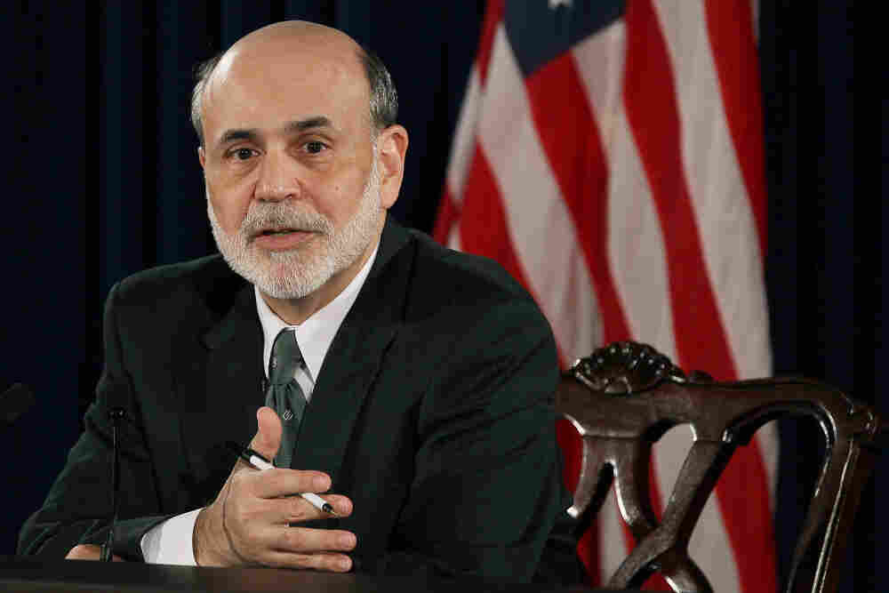 Federal Reserve Chairman Ben Bernanke speaks during a press briefing at the Federal Reserve building in Washington, DC.